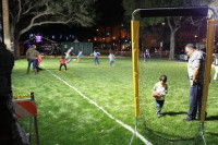 Children playing on the football field Plaza de Cesar Chavez